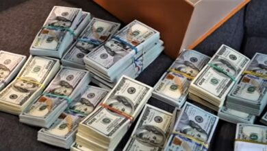 Photo of Cash, cars and cryptocurrency seized in ransomware raid